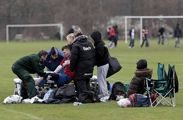 A player sits on the sidelines of Hackney marshes following a Sunday League Injury