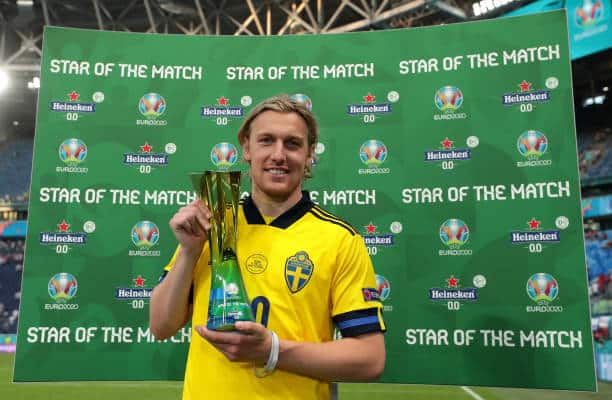 """SAINT PETERSBURG, RUSSIA - JUNE 23: Emil Forsberg of Sweden poses for a photograph with the Heineken """"Star of the Match"""" award after the UEFA Euro 2020 Championship Group E match between Sweden and Poland at Saint Petersburg Stadium on June 23, 2021 in Saint Petersburg, Russia. (Photo by Gonzalo Arroyo - UEFA/UEFA via Getty Images)"""