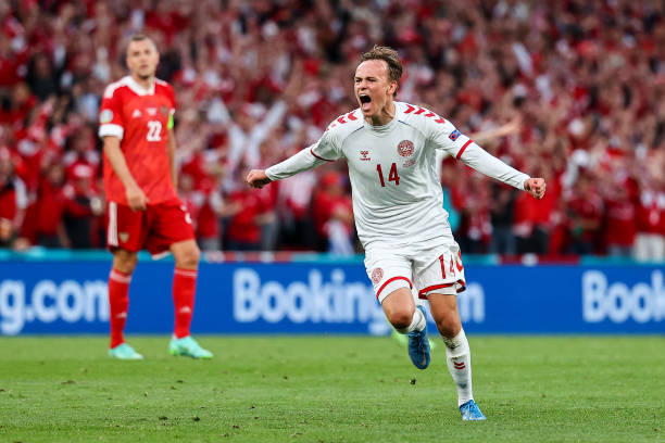 COPENHAGEN, DENMARK - JUNE 21: Mikkel Damsgaard of Denmark celebrates after scoring their side's first goal during the UEFA Euro 2020 Championship Group B match between Russia and Denmark at Parken Stadium on June 21, 2021 in Copenhagen, Denmark. (Photo by Wolfgang Rattay - Pool/Getty Images)