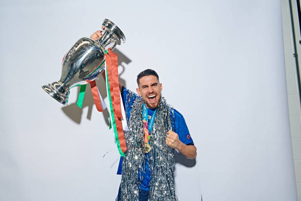 LONDON, ENGLAND - JULY 11: (EDITORS NOTE: Image has been digitally retouched) Jorginho of Italy poses with The Henri Delaunay Trophy during an Italy Portrait Session following their side's victory in the UEFA Euro 2020 Championship Final between Italy and England at Wembley Stadium on July 11, 2021 in London, England. (Photo by Michael Regan - UEFA/UEFA via Getty Images)