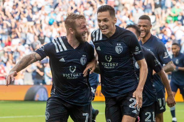 MLS All-Star Daniel Salloi (right) celebrating a SKC goal along with best mate Johnny Russell (Photo by Nick Tre. Smith/Icon Sportswire via Getty Images)