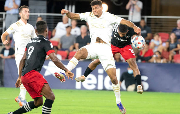 WASHINGTON, DC - AUGUST 21: D.C. United forward Edison Flores (10) heads the ball down behind Atlanta United defender Miles Robinson (12) during an MLS match between DC United and Atlanta United FC, on August 21, 2021, at Audi Field, in Washington DC. Miles is in the TOTW (Photo by Tony Quinn/Icon Sportswire via Getty Images)