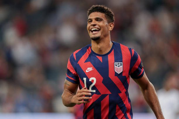 KANSAS CITY, KS - JULY 15: Miles Robinson #12 of the United States scores and celebrates during a game between Martinique and USMNT at Children's Mercy Park on July 15, 2021 in Kansas City, Kansas. Could Miles start in World Cup qualifying? (Photo by John Dorton/ISI Photos/Getty Images)
