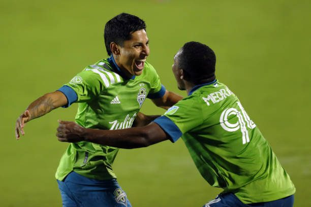 FRISCO, TX - AUGUST 18: Raúl Ruidíaz #9 of Seattle Sounders FC celebrates with his teammate Jimmy Medranda # 94 after scoring his team's first goal during the MLS game between FC Dallas and Seattle Sounders FC at at Toyota Stadium on August 18, 2021 in Frisco, Texas.  (Photo by Omar Vega/Getty Images)