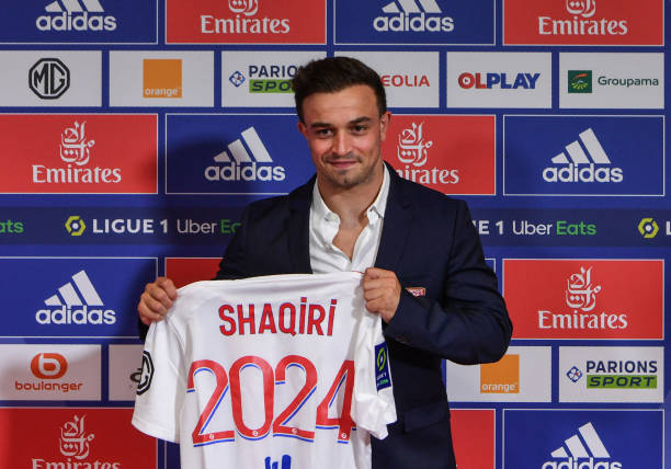 Swiss forward Xherdan Shaqiri holds his Olympique Lyonnais' new jersey during an official presentation at the Groupama Stadium in Decines-Charpieu near Lyon, southeastern France, on August 25, 2021, late in the window. (Photo by PHILIPPE DESMAZES / AFP) (Photo by PHILIPPE DESMAZES/AFP via Getty Images)